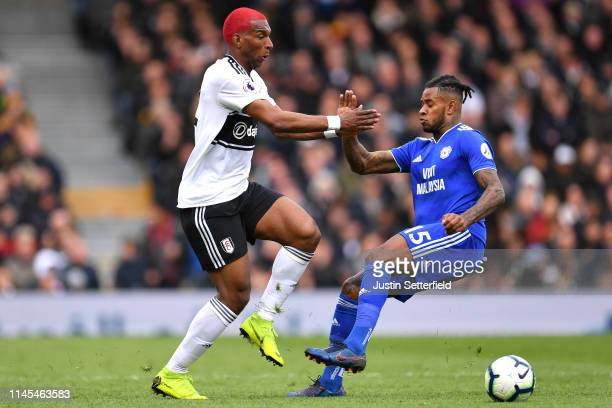 Ryan Babel of Fulham and Leandro Bacuna of Cardiff City clash during the Premier League match between Fulham FC and Cardiff City at Craven Cottage on...