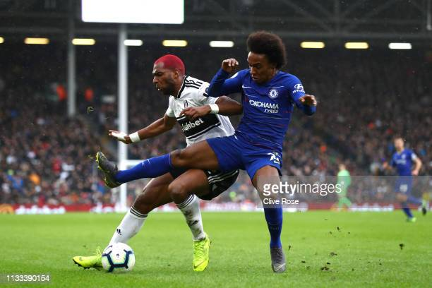 Ryan Babel of Fulham and Willian of Chelsea clash during the Premier League match between Fulham FC and Chelsea FC at Craven Cottage on March 03 2019...