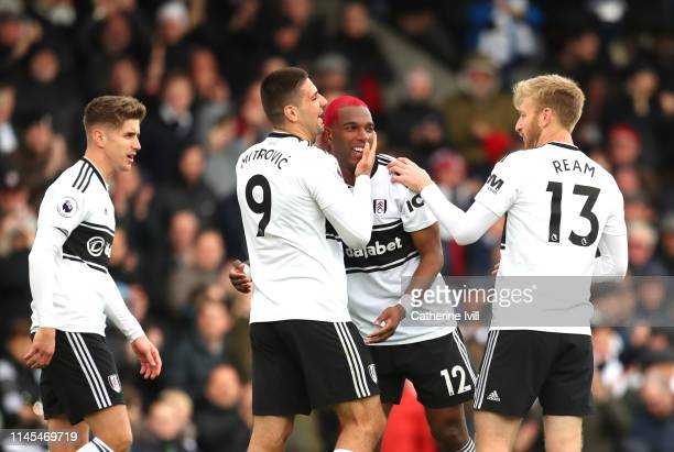 Ryan Babel of Fulham celebrates after scoring his team's first goal with team mates during the Premier League match between Fulham FC and Cardiff...