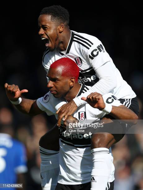 Ryan Babel of Fulham celebrates after scoring his team's second goal with Ryan Sessegnon of Fulham during the Premier League match between Fulham FC...