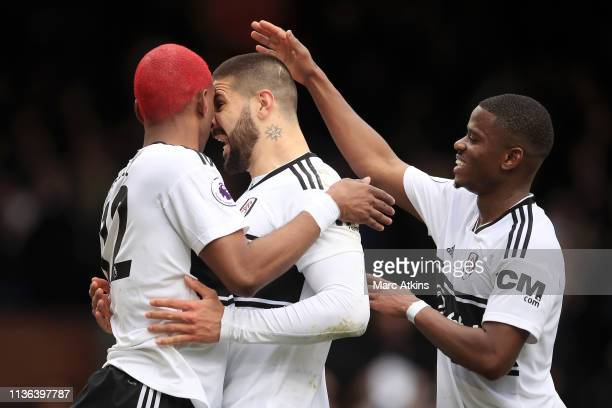 Ryan Babel of Fulham celebrates with Aleksandar Mitrovic of Fulham after he scores his sides first goal during the Premier League match between...