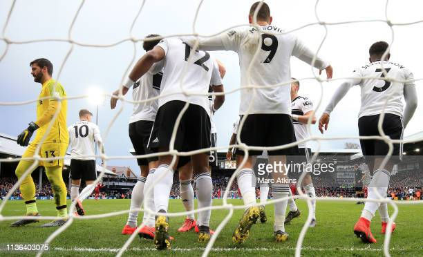 Ryan Babel of Fulham celebrates with his team after he scores his sides first goal during the Premier League match between Fulham FC and Liverpool FC...