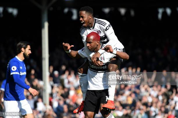 Ryan Babel of Fulham celebrates with teammate Ryan Sessegnon after scoring his team's second goal during the Premier League match between Fulham FC...
