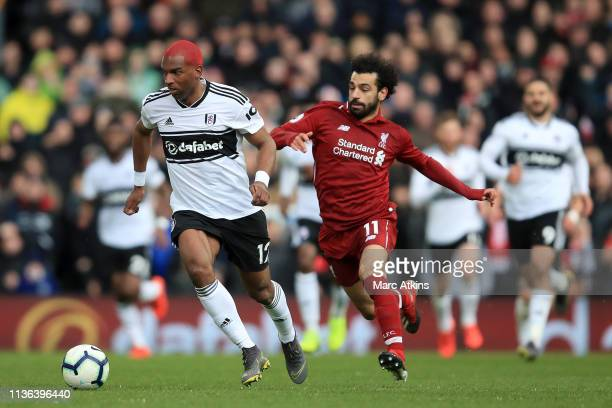 Ryan Babel of Fulham controls the ball as Mohamed Salah of Liverpool chases during the Premier League match between Fulham FC and Liverpool FC at...