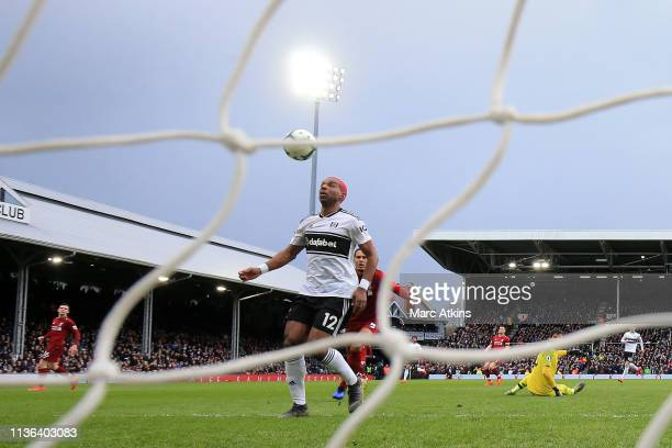 Ryan Babel of Fulham scores his sides first goal during the Premier League match between Fulham FC and Liverpool FC at Craven Cottage on March 17,...