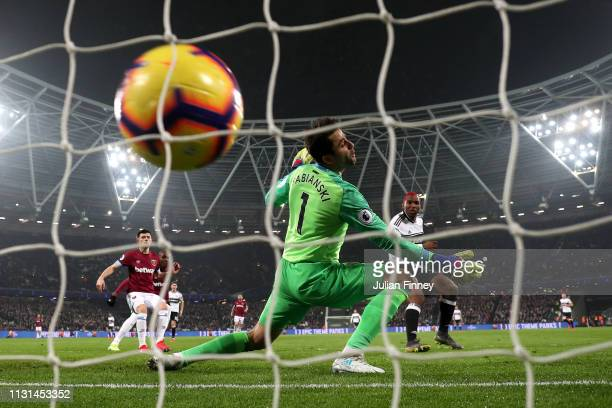 Ryan Babel of Fulham scores his side's first goal past Lukasz Fabianski of West Ham United during the Premier League match between West Ham United...