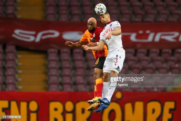 Ryan Babel of Galatasaray and Vitor Hugo of Trabzonspor during the Super Lig match between Galatasaray and Trabzonspor at Turk Telekom Stadyumu on...
