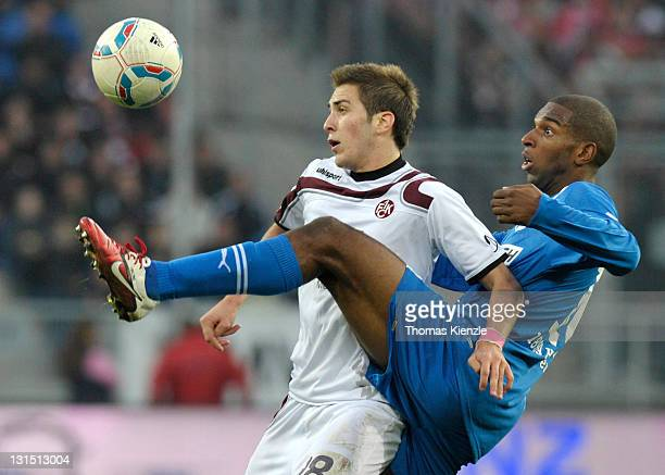 Ryan Babel of Hoffenheim and Konstantinos Fortounis of Kaiserslautern vie for the ball during the Bundesliga match between 1899 Hoffenheim and 1 FC...
