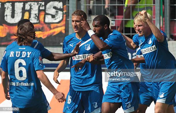 Ryan Babel of Hoffenheim celebrates with his team mates after scoring his team's first goal during the Bundesliga match between FC Augsburg and 1899...