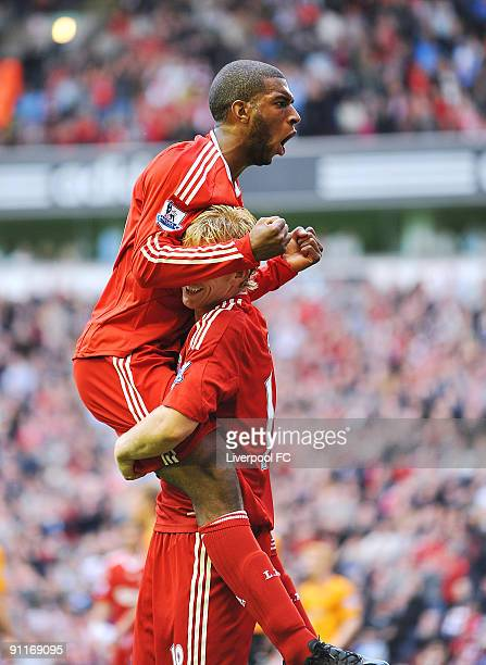 Ryan Babel of Liverpool celebrates with team mate Dirk Kuyt after scoring a goal to make it 5-1 during the Barclays Premier League match between...