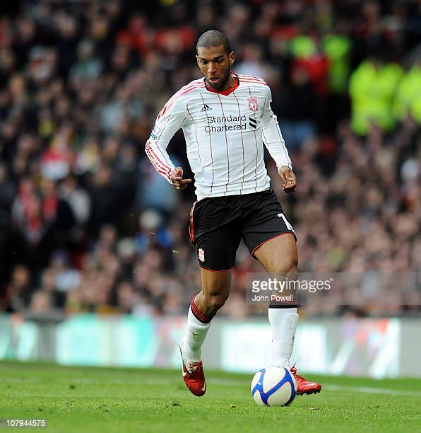 Ryan Babel of Liverpool goes for the ball during the FA Cup Sponsored by EON 3rd Round match between Manchester United and Liverpool at Old Trafford...