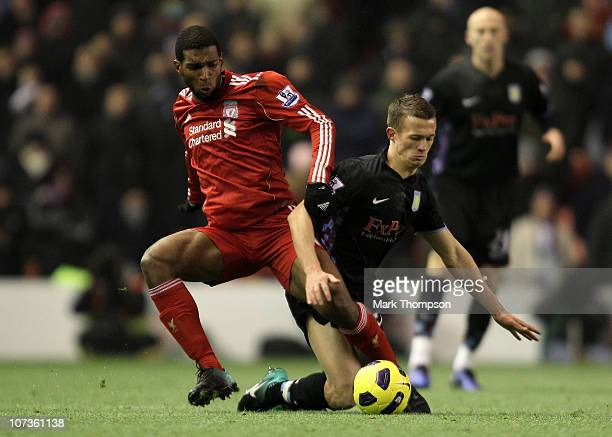 Ryan Babel of Liverpool tangles with Jonathan Hogg of Aston Villa during the Barclays Premier League match between Liverpool and Aston Villa at...