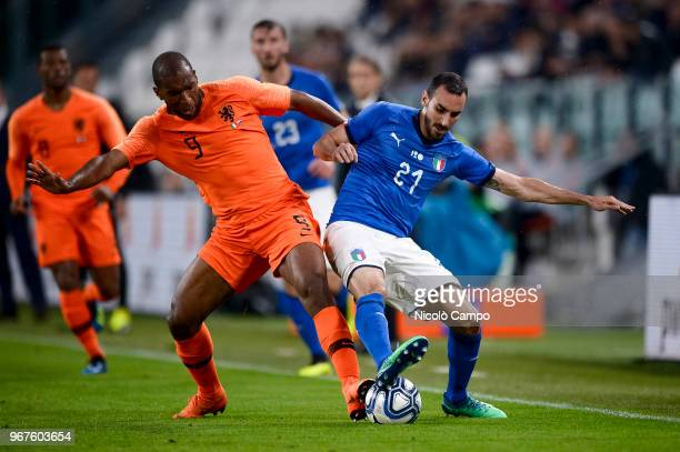 Ryan Babel of Netherlands and Davide Zappacosta of Italy compete for the ball during the International Friendly football match between Italy and...