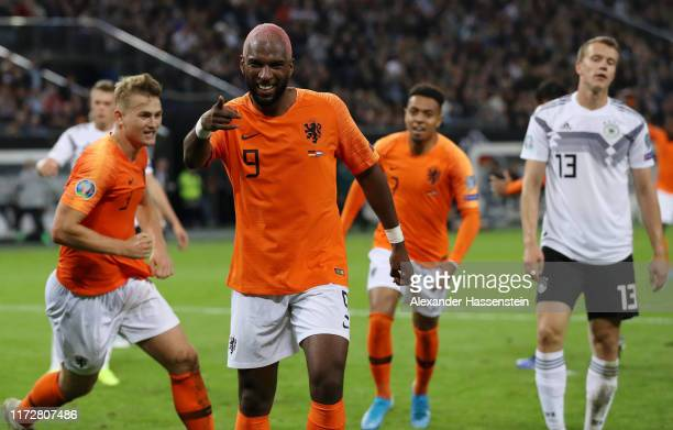 Ryan Babel of the Netherlands celebrates after Jonathan Tah of Germany scores an own goal for the Netherland's second goal during the UEFA Euro 2020...