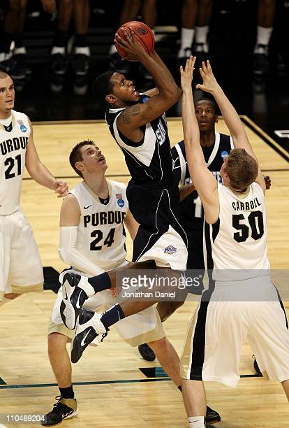 Ryan Bacon of the St Peter's Peacocks shoots against Travis Carroll of the Purdue Boilermakers in the second half during the second round of the 2011...