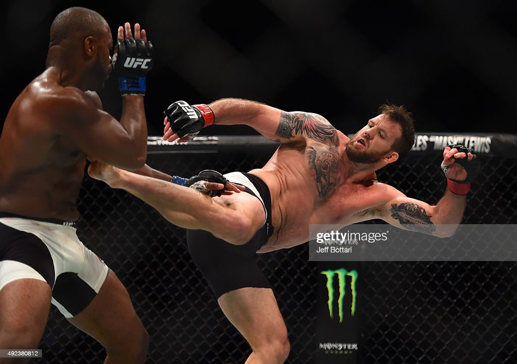 Ryan Bader kicks Rashad Evans in their light heavyweight bout during the UFC 192 event at the Toyota Center on October 3, 2015 in Houston, Texas.