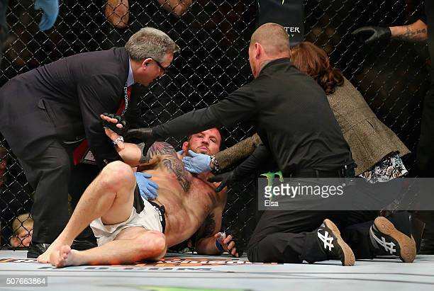 Ryan Bader of the United States is tended to after losing by TKO to Anthony Johnson of the United States in the first round of their light...