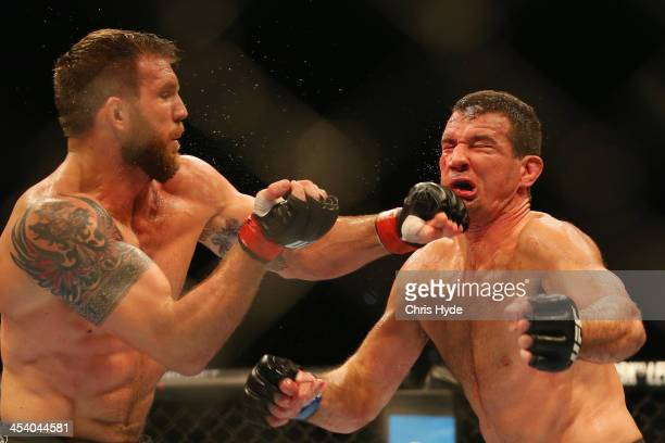 Ryan Bader of the USA punches Anthony Perosh of Australia in their light heavyweight fight during the UFC Fight Night event at Brisbane Entertainment...