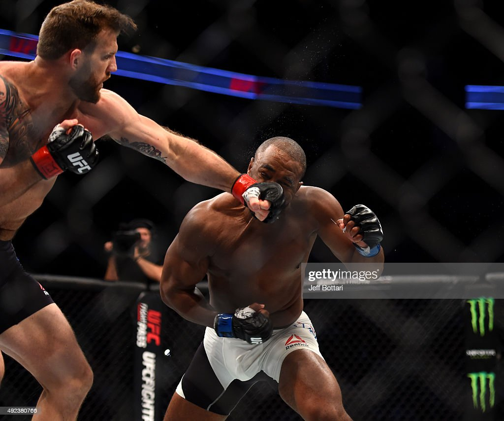 Ryan Bader punches Rashad Evans in their light heavyweight bout during the UFC 192 event at the Toyota Center on October 3, 2015 in Houston, Texas.