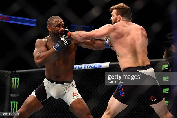 Ryan Bader punches Rashad Evans in their light heavyweight bout during the UFC 192 event at the Toyota Center on October 3 2015 in Houston Texas