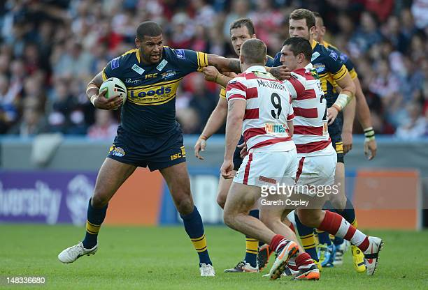 Ryan Bailey of Leeds is tackled Jack Hughes and Michael McIlorum of Wigan during the Carnegie Challenge Cup Semi Final match between Leeds Rhinos and...