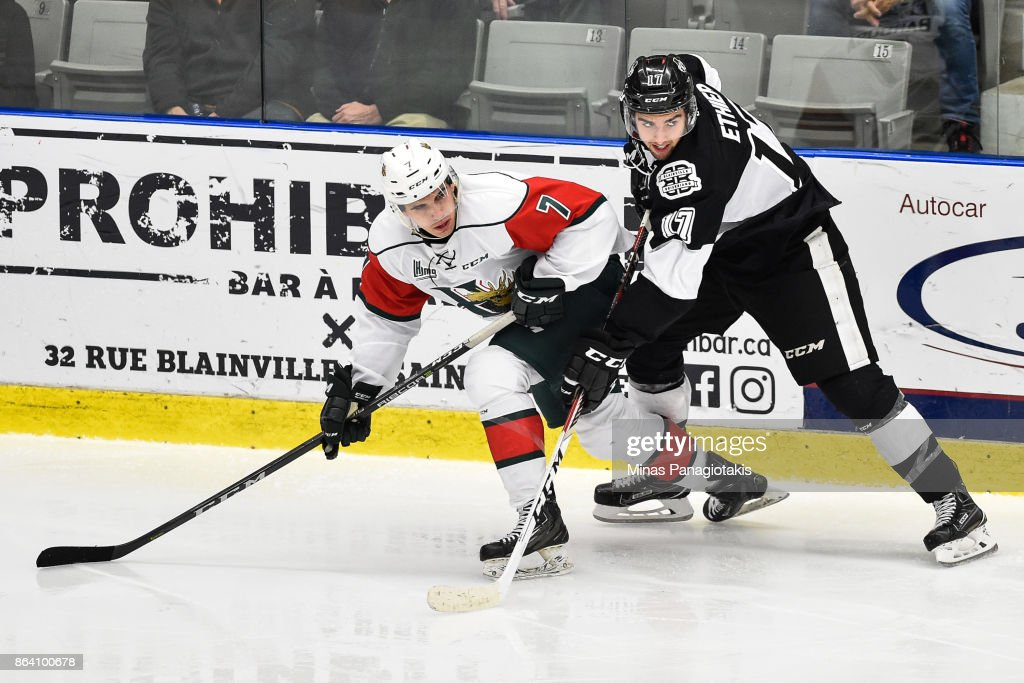 Ryan Barbosa #7 of the Halifax Mooseheads and Thomas Ethier #17 of the Blainville-Boisbriand Armada skate against each other during the QMJHL game at Centre d'Excellence Sports Rousseau on October 20, 2017 in Boisbriand, Quebec, Canada. The Halifax Mooseheads defeated the Blainville-Boisbriand Armada 4-2.