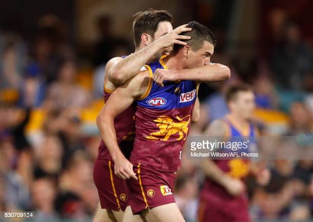 Ryan Bastinac and Tom Rockliff of the Lions celebrate during the 2017 AFL round 21 match between the Brisbane Lions and the Gold Coast Suns at the...