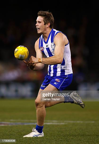 Ryan Bastinac of the Kangaroos handballs during the round 15 AFL match between the North Melbourne Kangaroos and the Richmond Tigers at Etihad...