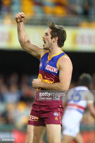 Ryan Bastinac of the Lions celebrates a goal during the round 20 AFL match between the Brisbane Lions and the Western Bulldogs at The Gabba on August...