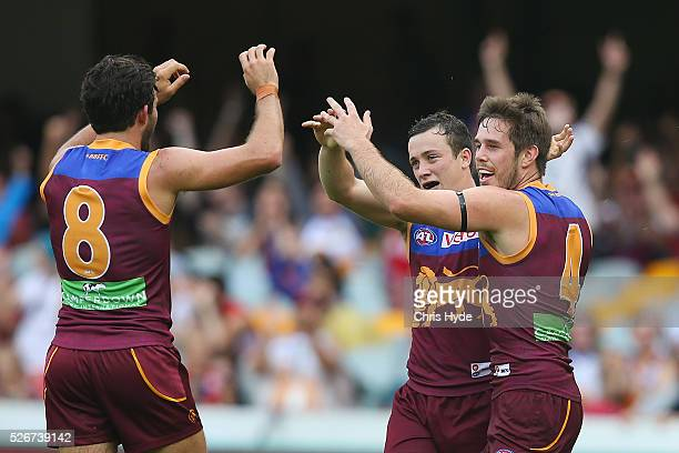 Ryan Bastinac of the Lions celebrates a goal during the round six AFL match between the Brisbane Lions and the Sydney Swans at The Gabba on May 1...