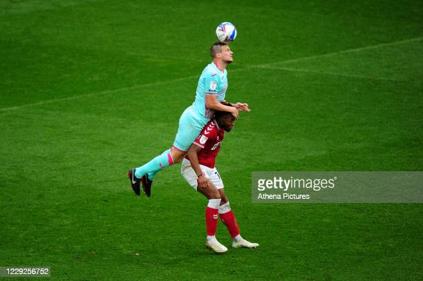 Ryan Bennett of Swansea City vies for possession with Antoine Semenyo of Bristol City during the Sky Bet Championship match between Bristol City and...