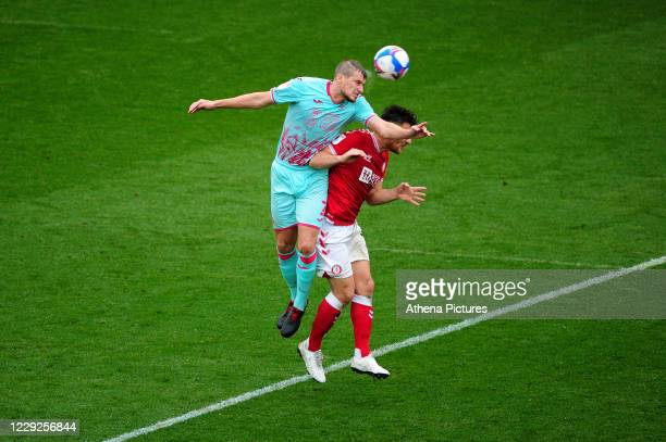 Ryan Bennett of Swansea City vies for possession with Chris Martin of Bristol City during the Sky Bet Championship match between Bristol City and...