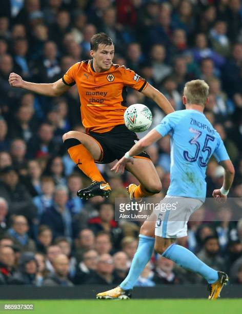 Ryan Bennett of Wolverhampton Wanderers and Alexander Zinchenko of Manchester City in action during the Carabao Cup Fourth Round match between...