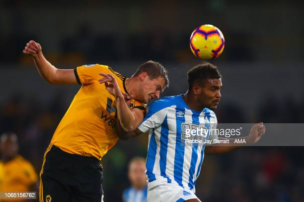 Ryan Bennett of Wolverhampton Wanderers and Steve Mounie of Huddersfield Town during the Premier League match between Wolverhampton Wanderers and...