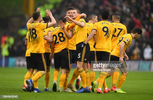 Ryan Bennett of Wolverhampton Wanderers celebrates with teammates after scoring his team's second goal during the Premier League match between...
