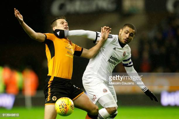 Ryan Bennett of Wolverhampton Wanderers competes with Leon Clarke of Sheffield United during the Sky Bet Championship match between Wolverhampton and...
