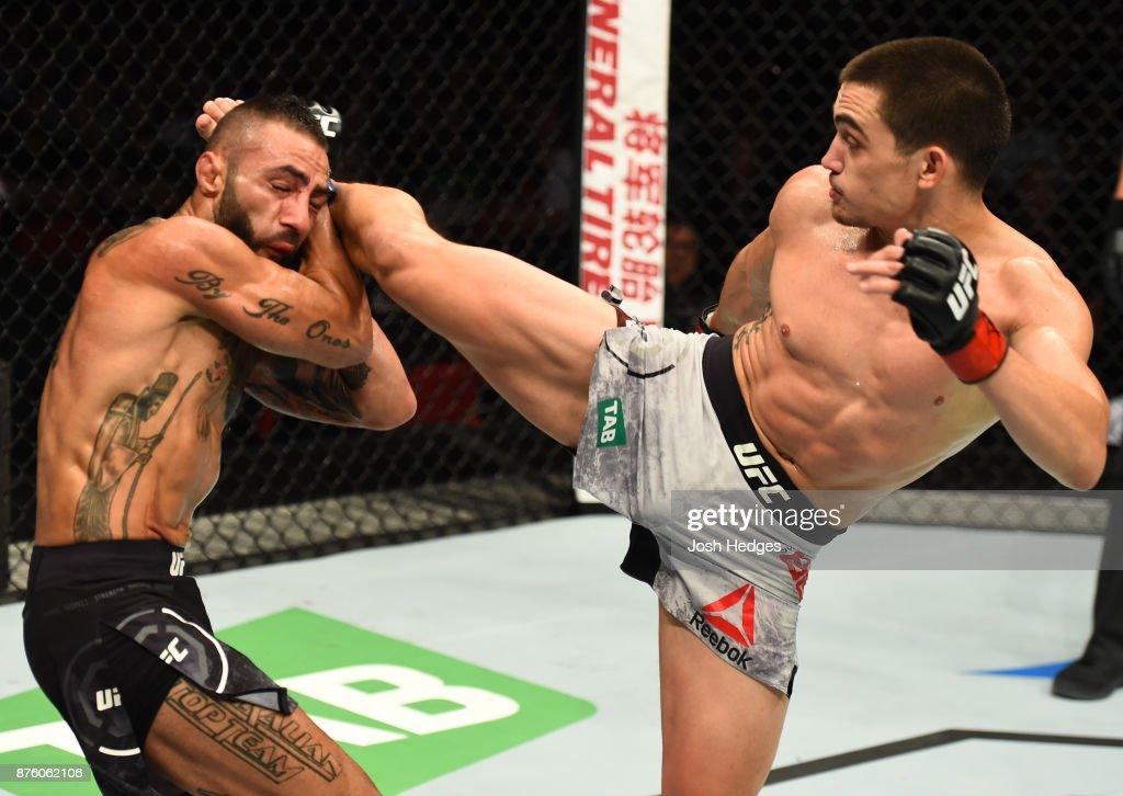 Ryan Benoit kicks Ashkan Mokhtarian of Iran in their flyweight bout during the UFC Fight Night event inside the Qudos Bank Arena on November 19, 2017 in Sydney, Australia.