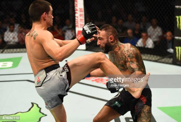 Ryan Benoit knocks out Ashkan Mokhtarian of Iran in their flyweight bout during the UFC Fight Night event inside the Qudos Bank Arena on November 19,...