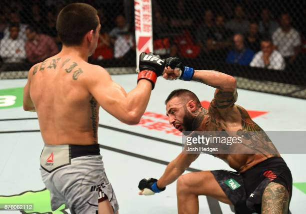 Ryan Benoit knocks out Ashkan Mokhtarian of Iran in their flyweight bout during the UFC Fight Night event inside the Qudos Bank Arena on November 19...