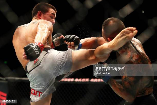 Ryan Benoit of the USA knocks out Ashkan Mokhtarian of Iranwith a kick in their flyweight bout during the UFC Fight Night at Qudos Bank Arena on...