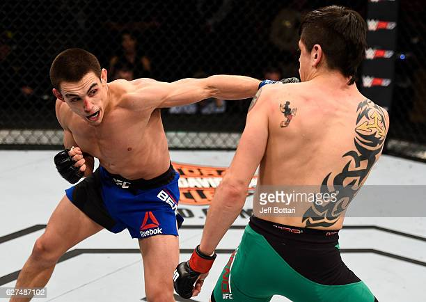 Ryan Benoit punches Brandon Moreno of Mexico in their flyweight bout during The Ultimate Fighter Finale event inside the Pearl concert theater at the...