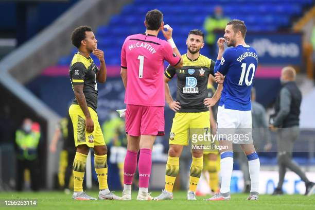 Ryan Bertrand Alex McCarthy and Shane Long of Southampton speak to Gylfi Sigurdsson of Everton after the Premier League match between Everton FC and...