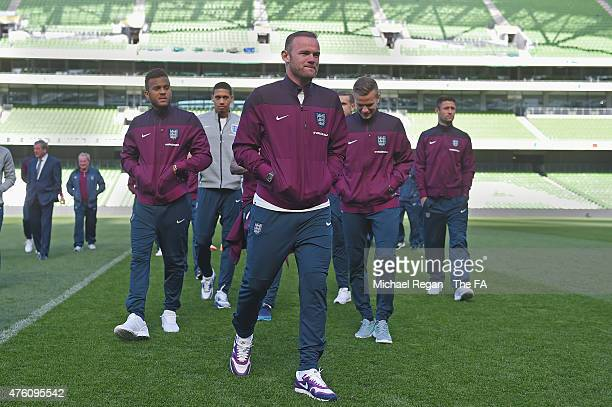 Ryan Bertrand, Chris Smalling, Wayne Rooney, Tom Cleverley and Gary Cahill look on during a team walk around at the Aviva Stadium on June 6, 2015 in...