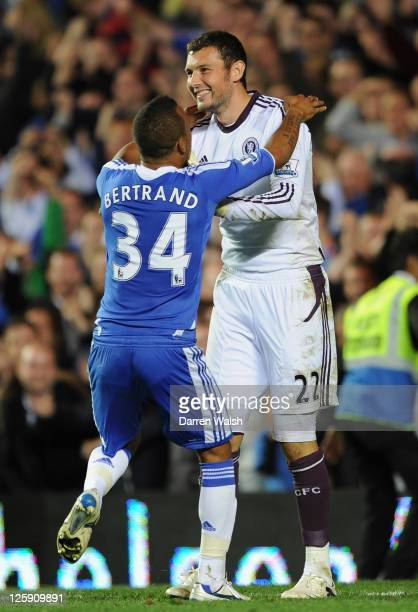Ryan Bertrand of Chelsea celebrates with goalkeeper Ross Turnbull after a penalty shootout victory during the Carling Cup Third Round match between...