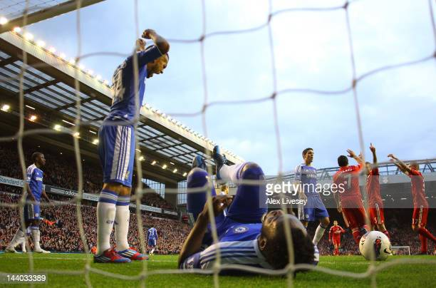 Ryan Bertrand of Chelsea shows his frustration as Daniel Agger of Liverpool celebrates scoring their third goal with Luis Suarez and Martin Skrtel of...