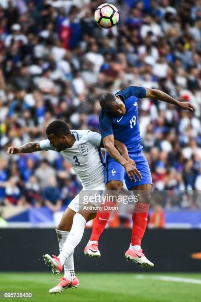 Ryan Bertrand of England and Djibril Sidibe of France fights for the ball during the International friendly match between France and England at Stade...