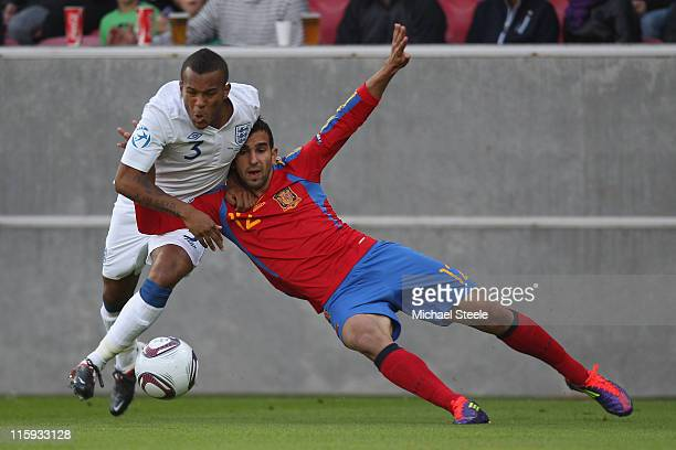 Ryan Bertrand of England and Martin Montoya of Spain during the UEFA European Under21 Championship Group B match between England and Spain at the...