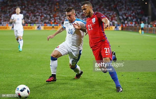 Ryan Bertrand of England and Robert Mak of Slovakia compete for the ball during the UEFA EURO 2016 Group B match between Slovakia and England at...