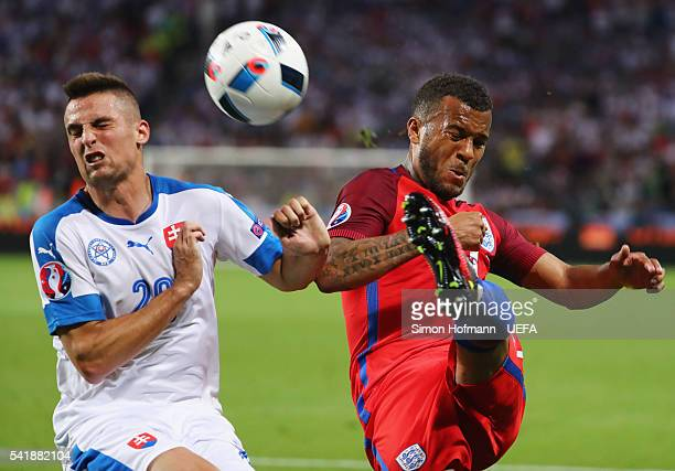 Ryan Bertrand of England and Robert Mak of Slovakia in action during the UEFA EURO 2016 Group B match between Slovakia and England at Stade...
