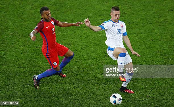 Ryan Bertrand of England challenges Robert Mak of Slovakia during the UEFA EURO 2016 Group B match between Slovakia and England at Stade...